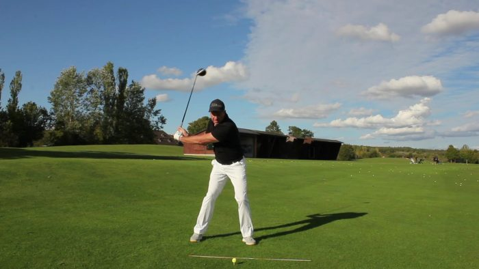 Throw the Head Back Late in the Downswing!